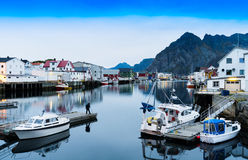 Horizontal vivid Norway town mountain quay reflections lights ba Stock Photography