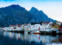 Horizontal vivid Norway town pier with reflections lights Stock Photo