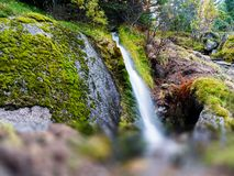 Horizontal vivid Norway waterfall flow bokeh abstraction nature. Background backdrop medium format vibrant bright color composition design concept element stock photos