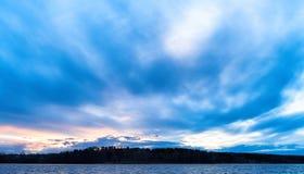 Horizontal vivid ocean cloudscape forest horizon Stock Photography