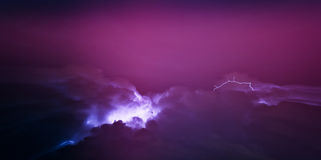 Horizontal vivid pink lightning storm cloudscape Royalty Free Stock Image