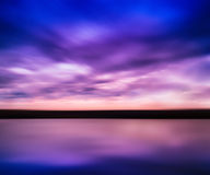 Horizontal vivid pink purple river sunset with reflection horizo Royalty Free Stock Photo