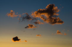 Horizontal vivid sunset cloudscape with flying birds background Stock Photo