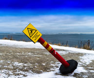 Horizontal vivid tilted risk of falling sign royalty free stock photos