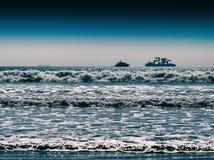 Horizontal vivid two ships in ocean tidal waves Stock Photos