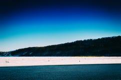 Horizontal vivid winter fishing on lake landscape Royalty Free Stock Photo