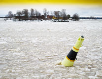Horizontal vivid yellow air bomb in ice Royalty Free Stock Images