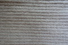 Horizontal wales on grey handmade knitwork from above. Horizontal wales on grey hand made knitwork from above Stock Image