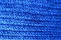 Horizontal wales on handmade electric blue knitted fabric Stock Photo