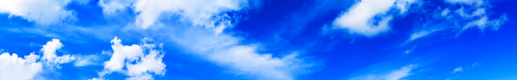 Horizontal wide high altitude dramatic blue loudscape panorama b Stock Photos