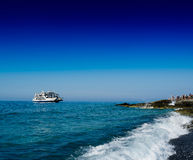 Horizontal wide ship arriving people meeting at quay Royalty Free Stock Image