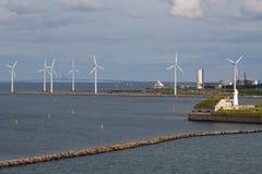 Horizontal wind turbine generators and breakwater Stock Photography