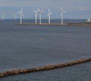 Horizontal wind turbine generators and breakwater Royalty Free Stock Photo