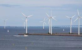 Horizontal wind turbine generators and sailing shi Royalty Free Stock Images