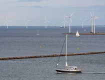Horizontal wind turbine generators and sailing shi Royalty Free Stock Photo