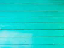 Horizontal wooden background. Is carefully painted with green paint Stock Photos
