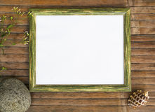Horizontal wooden frame with white page photo background. Stock Photo