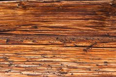 Horizontal wooden planks of an old Swiss mountain hut darkened by the sun and winter weather of the Alps, Switzerland.  royalty free stock photography