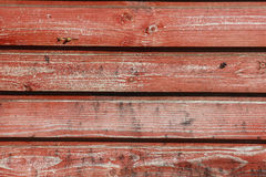 Horizontal wooden planks with peeling red paint, drops of resin Royalty Free Stock Images