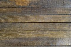Horizontal wooden table background. Top view. Copy space. Horizontal wooden table background. Old dark brown burnt oak. Top view. Copy space. Close up. Natural stock photo