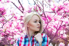 Horizontal young sexy blonde woman looking away with pink flower Stock Photography