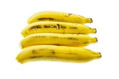 Horizontale Anordnung vieler Bananen lokalisiert auf weißem Hintergrund Lizenzfreie Stockfotos
