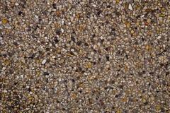 Horizontale Beschaffenheit der Sand-Beschaffenheit mit kleinem Stein Lizenzfreie Stockbilder