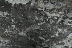 Horizontaler schwarzer rauer konkreter Boden-Beschaffenheits-Hintergrund Stockfotos