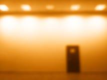 Horizontales Tür bokeh mit Glühenhintergrund des orange Lichtes Lizenzfreies Stockfoto