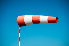 Horizontally flying windsock wind vane due to high wind. Stock Image