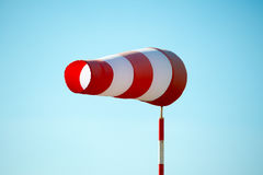 Horizontally flying windsock wind vane due to high wind. Royalty Free Stock Images
