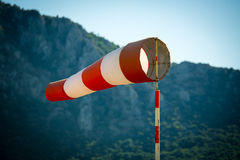 Horizontally flying windsock wind vane due to high wind. Stock Photo