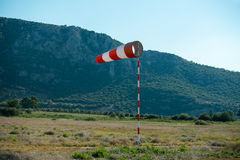Horizontally flying windsock wind vane due to high wind. Stock Photography