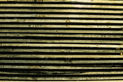 Horizontally lying wooden old bars Stock Image