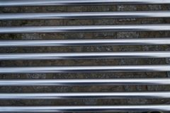 Horizontally placed stainless steel tubes hi-tech facade, iron texture.  Stock Images