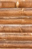 Horizontally tiled stained wood wall texture background.  Stock Photography