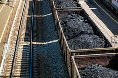 Freight carriadge with coal on the tracks Royalty Free Stock Photo