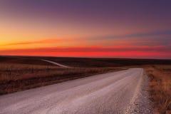 Horizonte da estrada do cascalho do país Foto de Stock