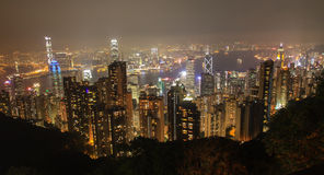 Horizonte de Hong-Kong en la noche Imagenes de archivo