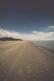 Horizonte de la playa con la arena y la perspectiva Fotos de archivo