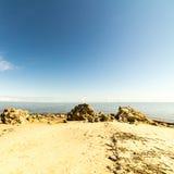 Horizonte de la playa con la arena y la perspectiva Fotografía de archivo