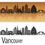 Horizonte de Vancouver V2 en fondo anaranjado imagenes de archivo