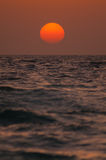 Horizonte inminente del sol anaranjado Imagen de archivo libre de regalías