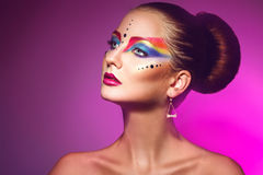Horizotnal portrait of attractive woman with multicolor make up Stock Photography