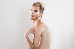 Horizotnal portrait of beautiful gay model with multicolor beard Stock Images