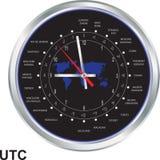 Horloge argentée avec des fuseaux horaires Images libres de droits