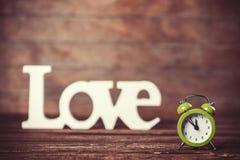 Horloge avec amour de mot Images libres de droits