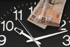 Horloge avec Dix livres Image libre de droits