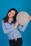 Horloge avec la femme dans le bleu Photo libre de droits
