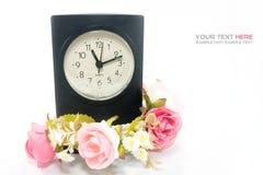 Horloge avec la fleur Image libre de droits